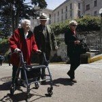 Betty Lou Vickery, 93, who lived on Alcatraz when it was a military prison, walks on a road near the cell block with Ranger John Cantwell and Rita Adams, her granddaughter-in-law, during Vickery's visit to the island.