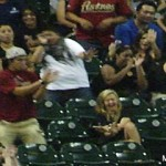 Most guys would try to catch a ball headed straight for their date, but not this Astros fan.
