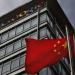 Chinese flag blows in air below Google