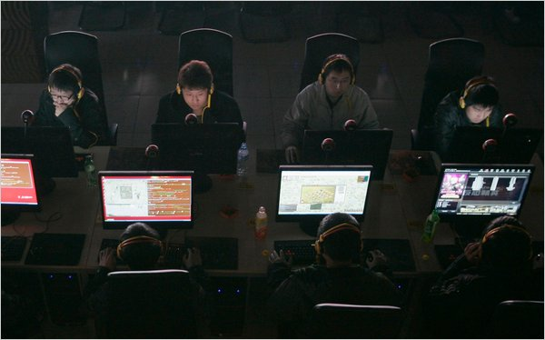 Customers use computers at an Internet cafe. Cables document the Politburo's near obsession with Chinese Internet users accessing politically delicate information.